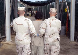 GUANTANAMO BAY, Cuba – JTF Guard Force Troopers transport a detainee