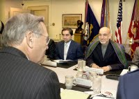Afghan President Hamid Karzai (right) and Minister of Foreign Affairs Abdullah Abdullah (center) meet with Secretary of Defense Donald H. Rumsfeld (left foreground) in the Pentagon on June 14, 2004