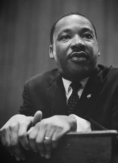 Martin Luther King, leaning on a lectern